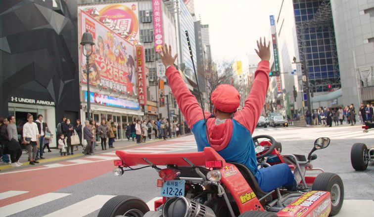 Man dressed in Mario Costume driving Mario Kart in Tokyo Japan | Japanoizy | Mario Kart in Tokyo | Japan Travel Video | ANYDOKO